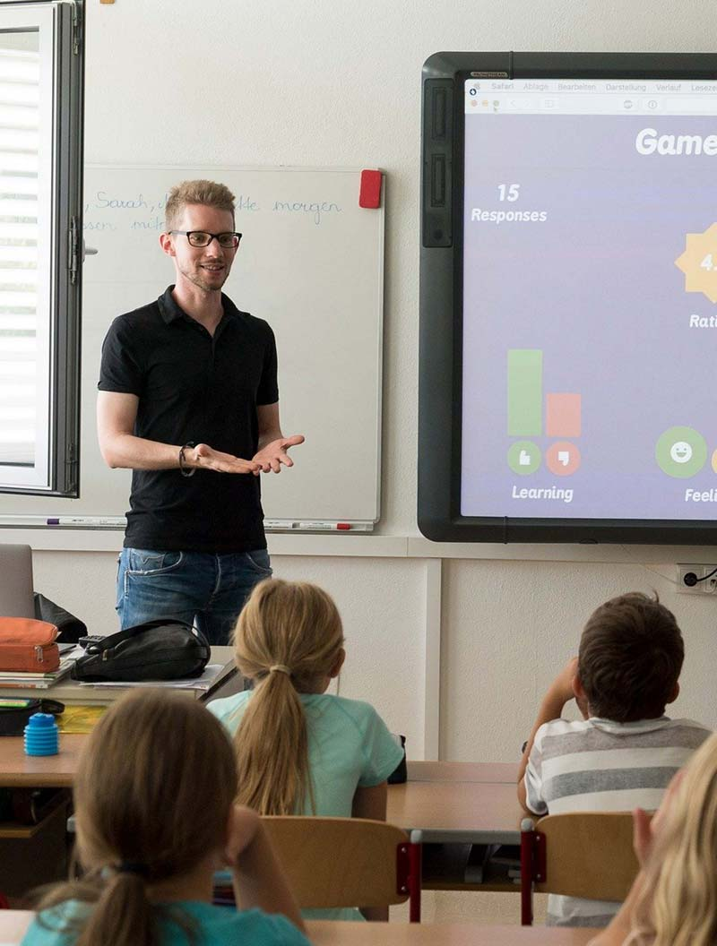 Man giving presentation to a group of students