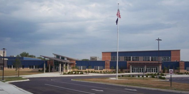 Charlestown High School with American flag