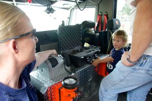 A child gets a first-rate tour of the inside of a fire truck duing the annual Koulee Kids Fest.