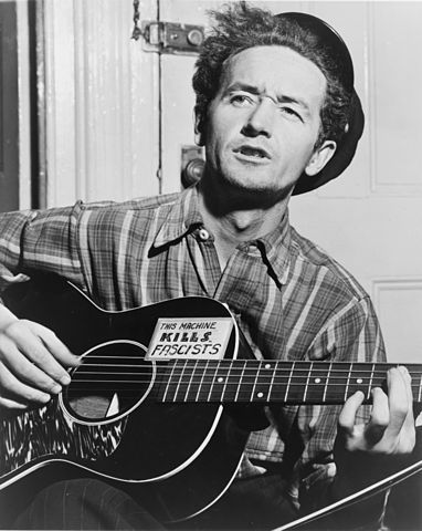 Woody Guthrie said his guitar was a fascist killer. Photo by New York World-Telegram and the Sun staff photographer Al Aumuller.