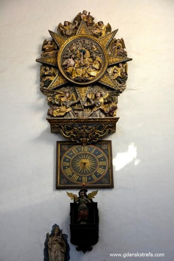 Zegar z aniolem i tablica, autor zdjęcia nieznany