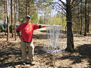 David McCormack during the installation of a new disc course in Park Hills Missouri
