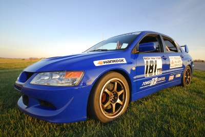 daily driven blue Mitsubishi Lancer Evolution VII race car
