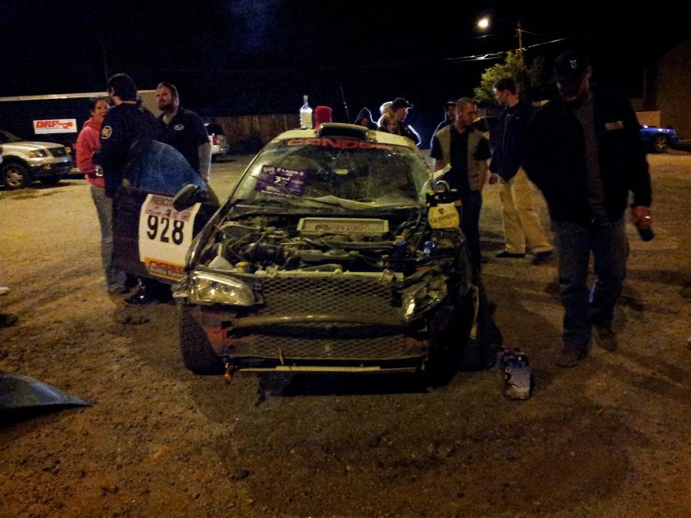 rolled subaru rally car