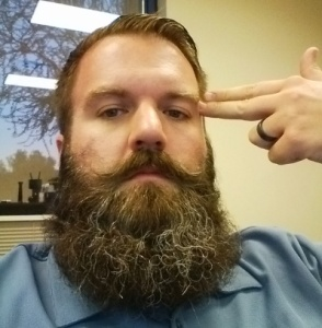 That's me. At work. With a 6-month old beard. Loving life.