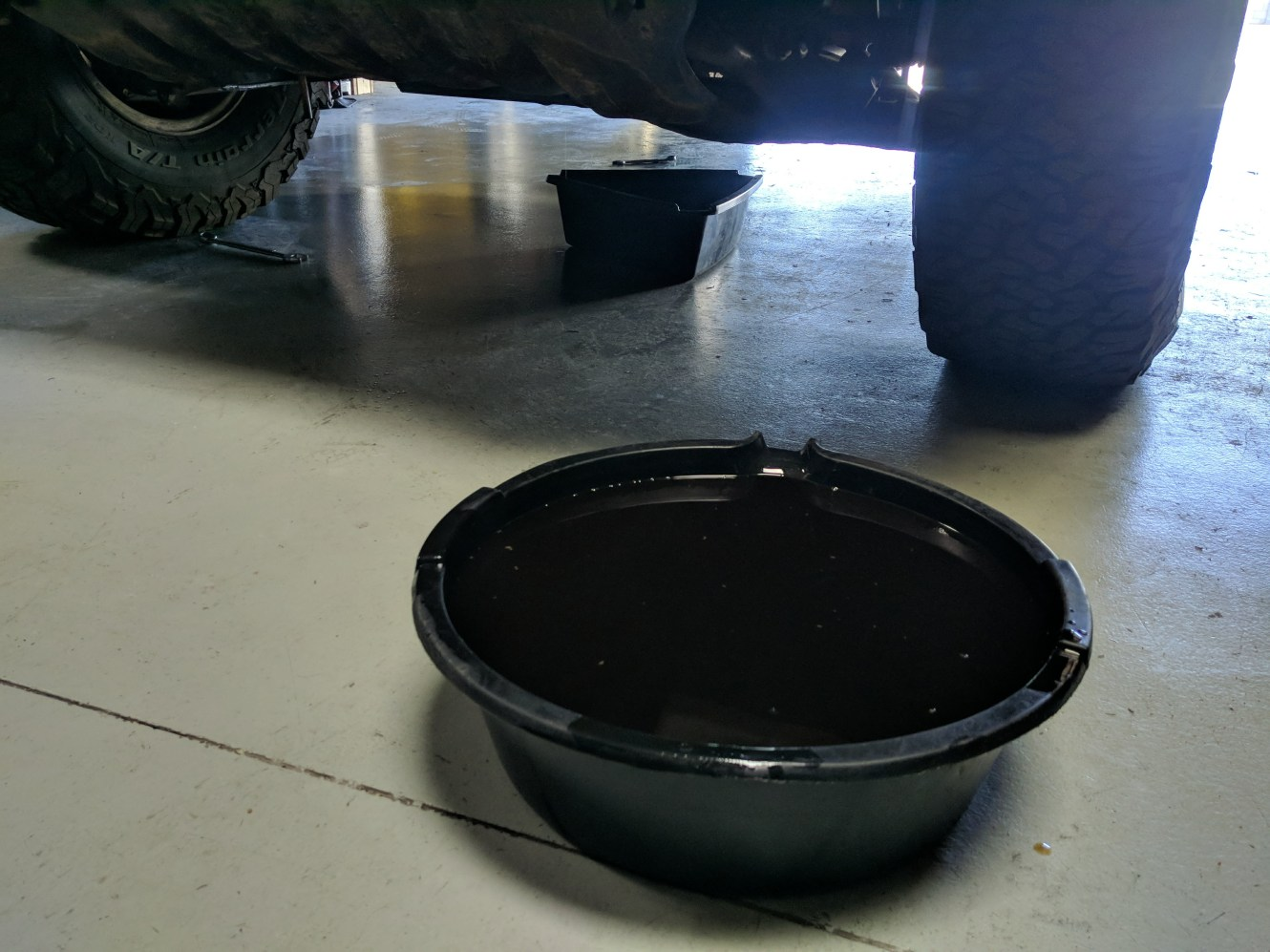 That's almost 9 quarts of oil in that pan. The transmission was draining into the other.
