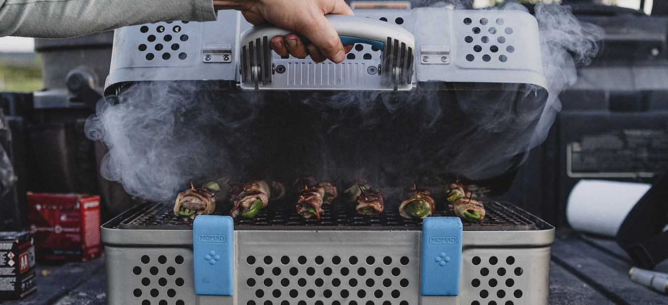 portable suitcase grill in action