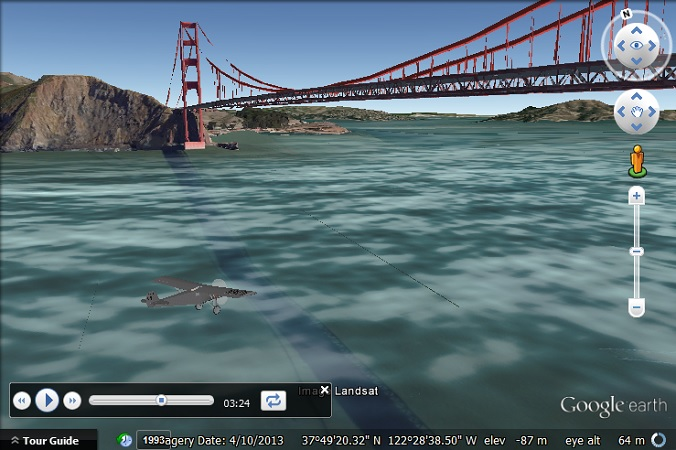 The Spirit of St. Louis flies under the Golden Gate Bridge