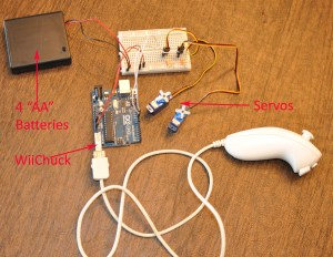 Wii Nunchuck connected to an Arduino Uno controls two servo motors.