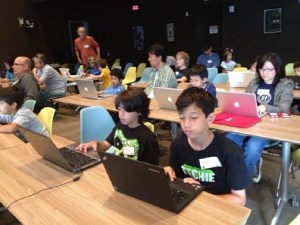 Kids and their parents working on Scratch programs at CoderDojo LA.