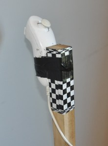 Sophisticated steering mechanism - a Wii Nunchuck attached to the handle with duck tape.