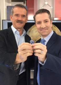 Commander Chris Hadfield and Michael Hainsworth show off a Hadfield guitar pick