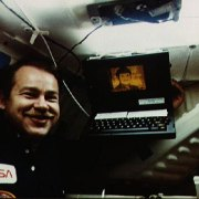 Astronaut John O. Creighton poses with onboard GRiD Compass computer, displaying a likeness of Mr. Spock of Star Trek, aboard Space Shuttle Discovery mission STS-51-G on 18 June 1985.