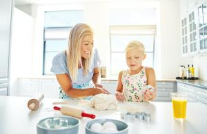 Pretty little girl learning to bake