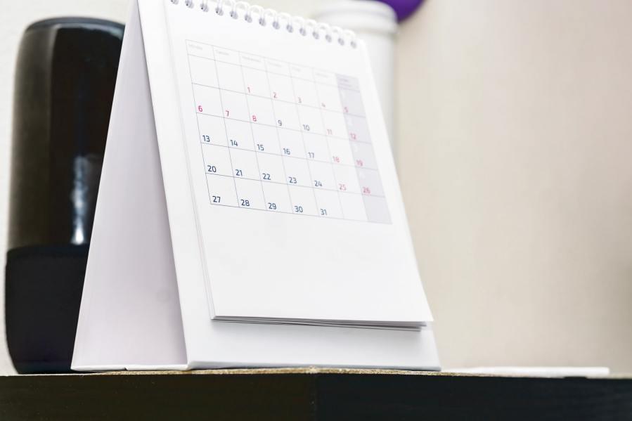 Calendar stands on a shelf. Deadline and office concept