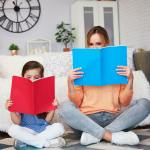 Mom and child reading a book in living room