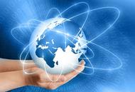 Internet globe held in hands representing freedom