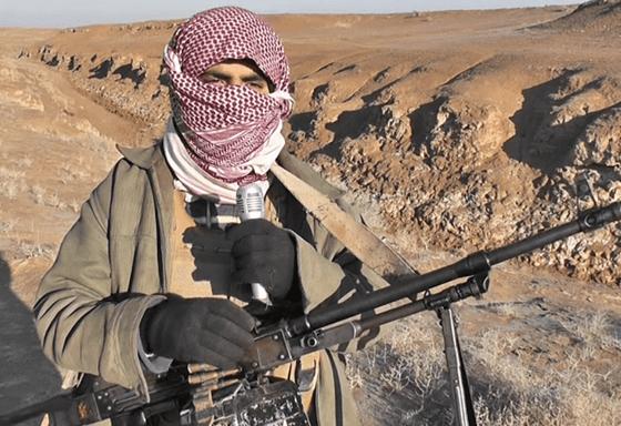 al-Qaida militant holding gun