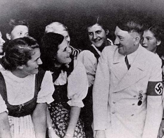 Hitler looking shy in front of girls