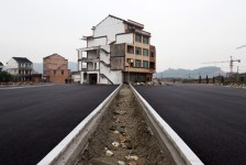 Chinese nail house in middle of highway - Wenling, China, 2012