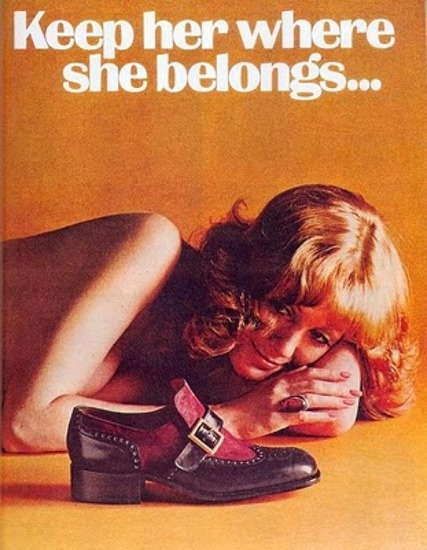 This shoe advertisement says women should grovel at the man's feet
