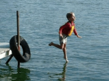 Well-timed picture makes child appear to be running across the water