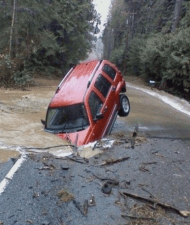 Well-timed photo shows car sticking out of sinkhole
