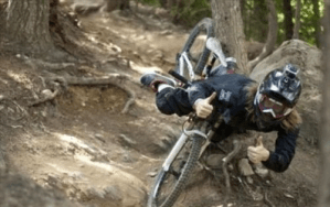 Perfectly timed photo - man gives thumbs up as he falls off of bicycle