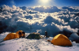 Well-timed photo on mountain top makes tents look like they're in the clouds