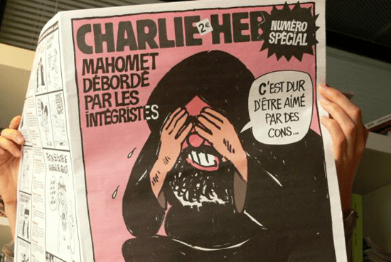 Charlie Hebdo reader reading one of their first controversial issues