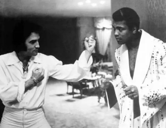 An older Elvis Presley showing legendary Muhammad Ali how to fight.
