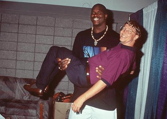 Shaq carrying Bill Gates.