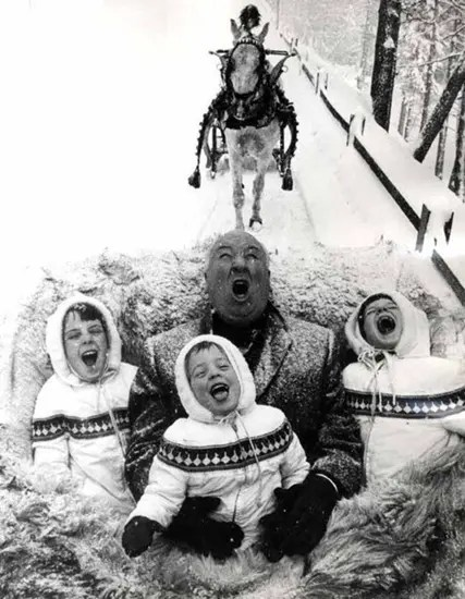 Alfred Hitchcock about to eat little children alive (i.e. Hitchcock enjoying a sleigh ride with his grandchildren).