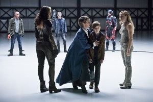 "DC's Legends of Tomorrow -- ""Last Refuge""-- Image LGN112b_0284b.jpg -- Pictured (L-R): Dominic Purcell as Mick Rory/Heat Wave, Ciara Renee as Kendra Saunders/Hawkgirl, Wentworth Miller as Leonard Snart/Captain Cold, Celia Imrie as Mary Xavier, Aiden Longworth as Young Rip Hunter, Brandon Routh as Ray Palmer/Atom and Caity Lotz as Sara Lance/White Canary -- Photo: Dean Buscher/The CW -- © 2016 The CW Network, LLC. All Rights Reserved."