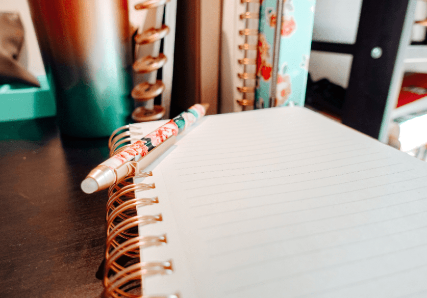 how to get back on track with your weight loss goals - notebook with a pen on it