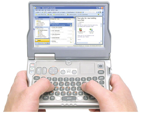 The concept has been further revised and given the name FlipStart - the LID (LCD Interactive Display) on the top of the device is now present, with membrane-type media control keys and media display function provided. More development of the keyboard. Specification at this stage appears to be Transmeta Crusoe at 1GHz, 256MB RAM, 8GB VRAM, 30GB HD, WiFi and USB.