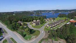 NY AVKJØRSEL: Det nye boligområdet vil få krysningspunkt ut på fv. 409. Fotomontasje: Privatmegleren Arendal