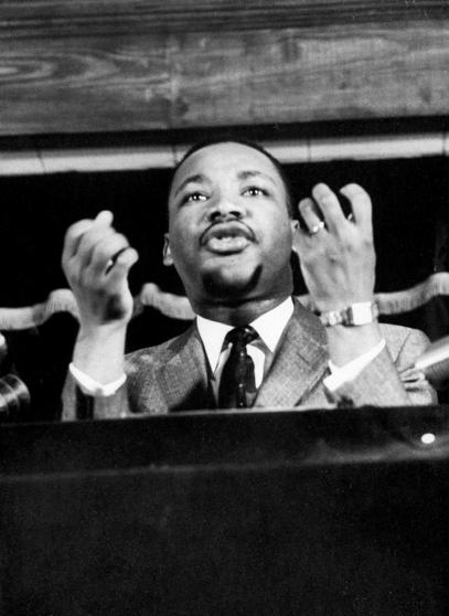 Civil rights leader Rev. Martin Luther King speaking from pulpit at mass meeting about principles of non-violence before leading assembly to ride newly integrated busses after successful boycott. (Photo by Don Cravens/The LIFE Images Collection/Getty Images)