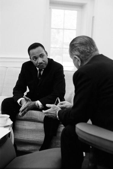 (L-R) Civil rights leader Dr. Martin Luther King speaking with President Lyndon Johnson during a visit to the White House.