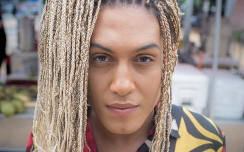Rosto de Raquel Virgínia, mulher negra com tranças