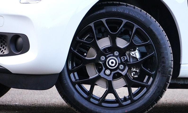 white car with alloy wheel