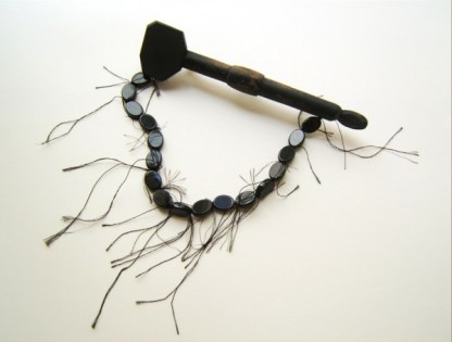 11. Mourning of that beauty. brooch. painted wood, onix, onix beads, thread, steel