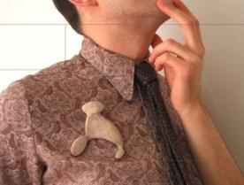 5. the silence II. brooch. horn, silver