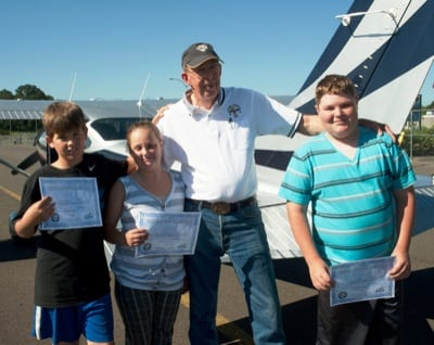 Larry Durst flew his 5,000th Young Eagle on June 7: Cole Brecht, 12 (far right) of Looking Glass, Ore. Also (l-r): Young Eagles Jesse Brecht, 10, and Lily Creekmore, 11.