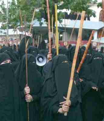 Protesting female students at Red Mosque seminary wearing burkas and carrying bamboo sticks in 2007