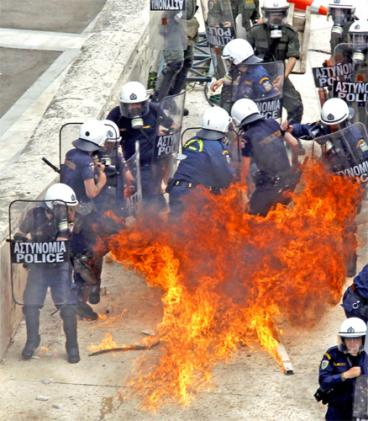 Athens rioting: A Molotov cocktail explodes among a group of riot police <font face=Arial size=-2>(Source: Independent)</font>