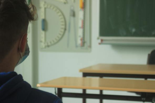Image of student wearing mask in classroom