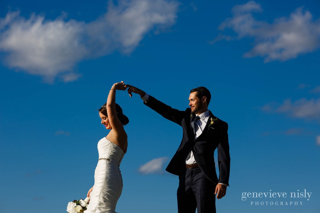 Bride and groom dance in front of a blue sky during their wedding at City Hall Rotunda in Cleveland, Ohio.