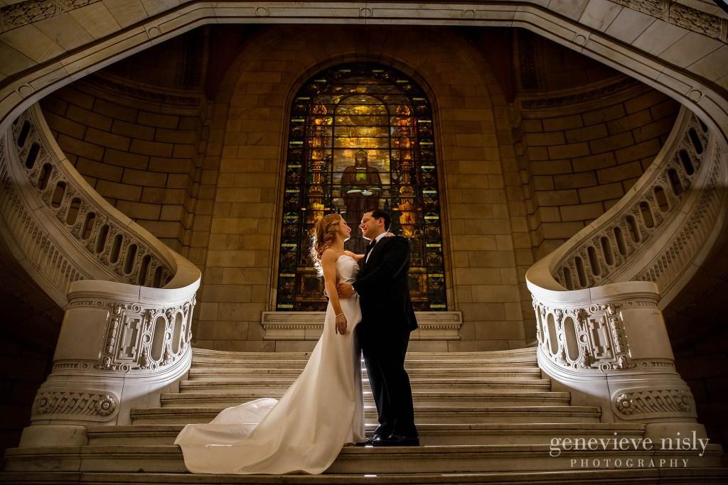 Wedding couple on the grand staircase at the old courthouse in Cleveland during the Cleveland Winter wedding at the Ritz Carlton.