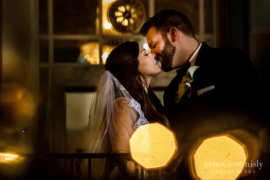 Wedding couple kisses during their wedding at Onesto Lofts.